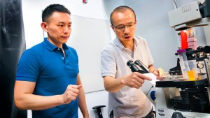 Xianwen Mao, left, and Peng Chen, the Peter JW Debye Professor of Chemistry, are pictured in the microscope room in Olin Research Laboratory Photo by Rocky Ye