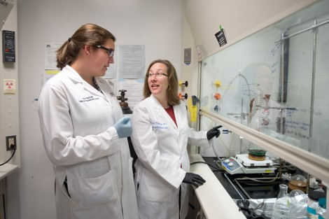 Nicole Levi-Polyachenko (right), associate professor of plastic and reconstructive surgery at Wake Forest School of Medicine, consults with graduate research associate Eleanor McCabe-Lankford as they check a batch of solution containing the polymer nanopa