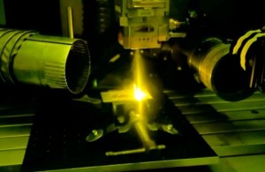 Inside NISTs laser welding booth, a high-power laser melts a piece of metal to form the letters NIST Credit Paul WilliamsNIST