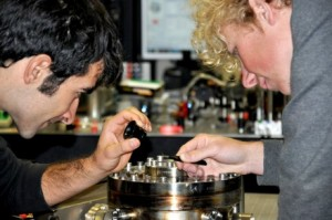 PhD students Giovanni Guccione L and Harry Slatyer examine their gold-coated silver gallium nanowire in the Quantum Optics labs Image Quantum Optics Group, ANU