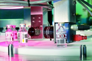 Pharmaceutical bottle inspection system for imaging 1D and 2D barcodes using an 85mm Edmund Optics Techspec Compact Fixed Focal Length lens to ensure high levels of accuracy for tracking and sorting