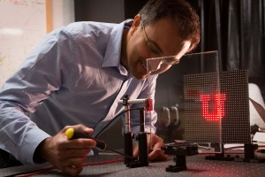 University of Utah electrical and computer engineering associate professor Rajesh Menon has discovered a way to create an optics-less camera in which a regular pane of glass or any see-through window can become the lens Photo credit Dan HixsonUniversity o