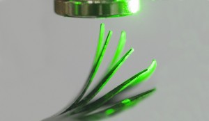 Incident light from right causes an elastomer film to deflect in a magnetic field
