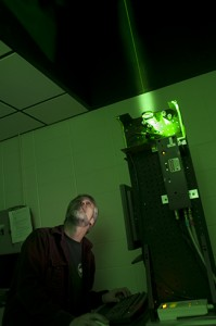 Joseph Shaw, Montana State University professor in electrical and computer engineering, works with a LIDAR light detection and ranging laser at MSUs engineering complex