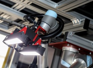 An automated guided vehicle is used to transport the console into the IVS robot vision inspection cell Two cameras on the end effecter of a robot then capture images of the subassembly which are then analyzed in software to determine the integrity of the