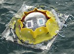 Testing solar cell performance for underwater applications Solar cells mounted inside a glass sphere are lowered into the water to a depth of 9 meters Instrumentation records both the solar cell performance and the solar spectrum underwater Credit US Nava