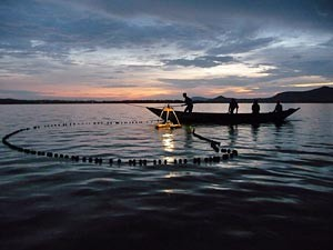 Omena fishermen in Kenya with Osram Energy Hub solar lighting