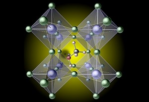 Artists concept illustration depicts a hydrogen vacancy the black spot left of center created by removing hydrogen from a methylammonium molecule, which traps carriers in the prototypical hybrid perovskite, mehtylammonium lead iodide CH3NH3Pbl3 Illustrati