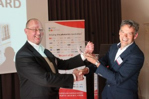 Pim Kat left, CEO and Founder of Technobis, receives the EPIC Phoenix Award 2015 from Benno Oderkerk right, member of the board of directors of EPIC