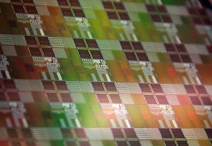 Silicon wafer with photonic-electronic microchips designed by CU research team