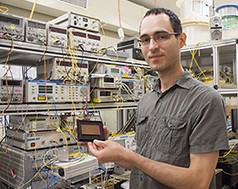 Dr Simon Lefrancois from the University of Sydneys School of Physics holding an optical chip used in the terabit oscilloscope