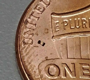The microrobot can be seen just to the right of the U in United States on this US penny Purdue University imageGeorges Adam