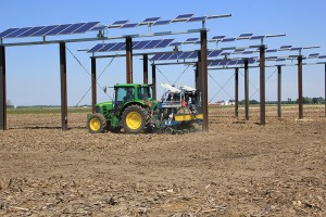 A tractor plants corn seed in early June around solar photovoltaic panels in a field north of the Agronomy Center for Research and Education The panels are part of the Sustainable Food, Energy and Water Systems SFEWS research project intended to examine h