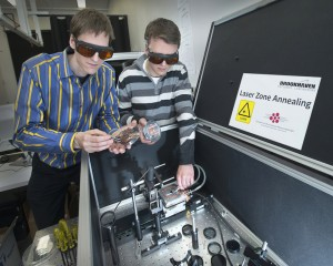 Brookhaven Lab scientist Kevin Yager left and postdoctoral researcher Pawel Majewski with the new Laser Zone Annealing instrument at the Center for Functional Nanomaterials