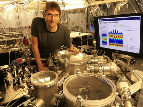 Thomas Gaumnitz, postdoctoral fellow in the group of ETH professor Hans Jakob Worner with the setup that generates the shortest laser pulses in the world. (Photograph: ETH Zurich)
