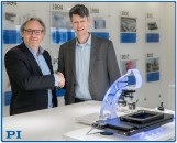 Stphane Bussa, Vice President of SalesMarketing, congratulates Dr Thomas Bocher on his appointment as Head of Segment Marketing MicroscopyLife Sciences