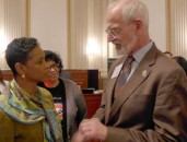 Rep Donna Edwards D-Maryland is congratulated by SPIE President-Elect Robert Lieberman